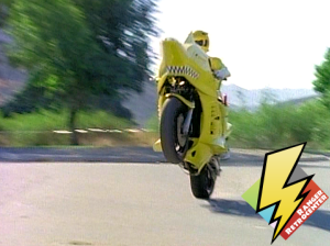 Yellow Shark Cycle performs a wheelie