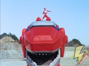 Red Ranger atop the Tyrannosaurus