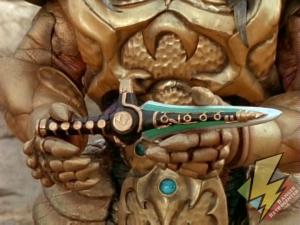 Goldar holds the Dragon Dagger