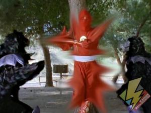Red Ninja Ranger hiding within a tree